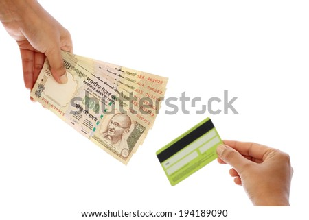 Hand with Indian rupee notes and debit card - stock photo