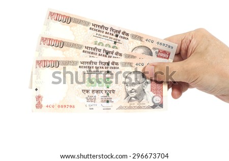 Hand with Indian thousand rupees notes isolated - stock photo