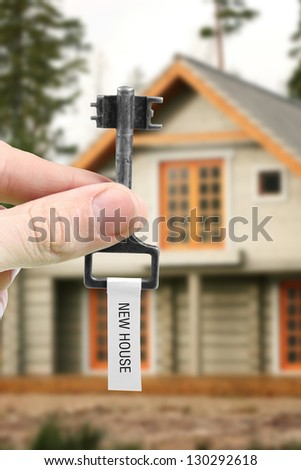 hand with key from new house - stock photo
