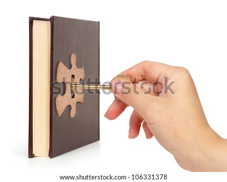 hand with key open the lock book, Book concept - stock photo