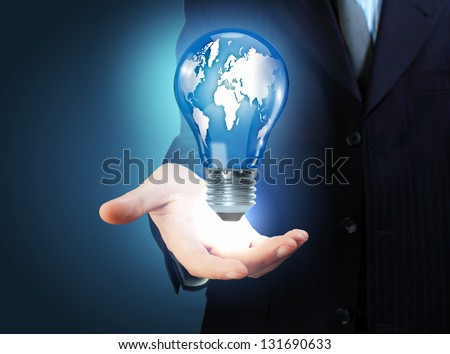 Hand with lamp and hands of a business person