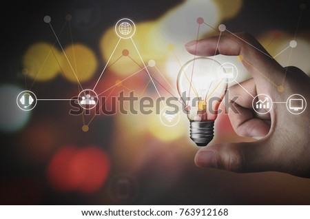 Hand with light bulb. Business Strategy Planning
