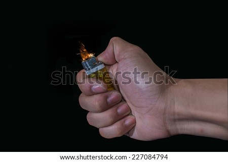 Hand with lighter igniting sparks - stock photo