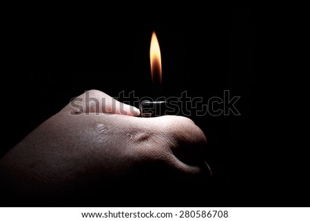 Hand with lighter igniting sparks