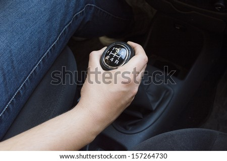 hand with manual gear shift lever close up - stock photo