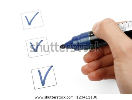 Hand with marker and check list