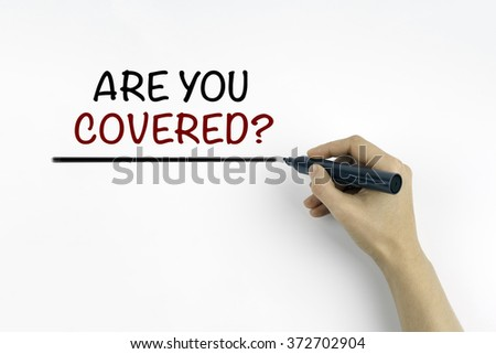 Hand with marker writing: Are you Covered? - stock photo