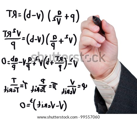 Hand with marker writing formulas and equations. - stock photo