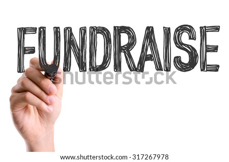 Hand with marker writing: Fundraise - stock photo