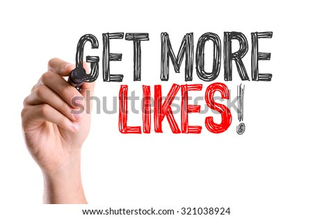 Hand with marker writing: Get More Likes - stock photo