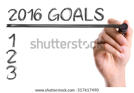 Hand with marker writing: 2016 Goals - stock photo