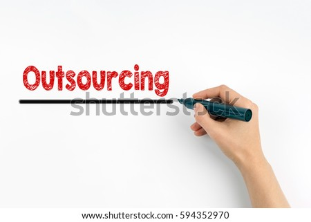Hand with marker writing - Outsourcing concept