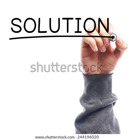Hand with marker writing Solution on transparent board against white background. - stock photo
