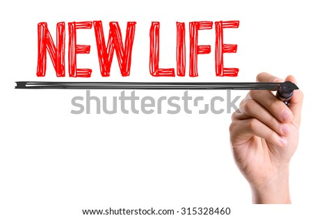 Hand with marker writing the text New Life - stock photo
