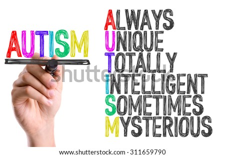 Hand with marker writing the word Autism - stock photo