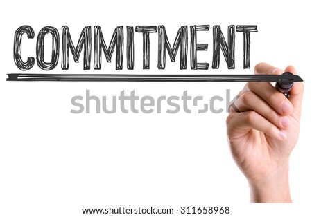 Hand with marker writing the word Commitment - stock photo