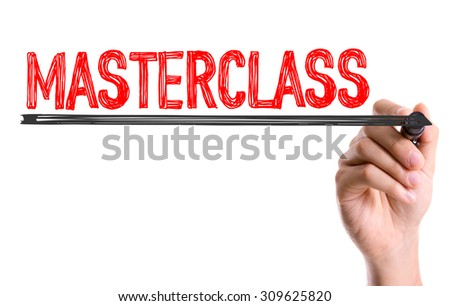 Hand with marker writing the word Masterclass - stock photo