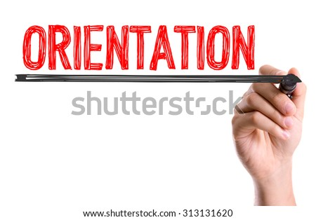 Hand with marker writing the word Orientation - stock photo