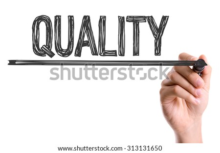 Hand with marker writing the word Quality - stock photo