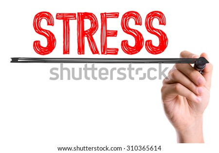 Hand with marker writing the word Stress - stock photo