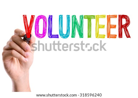 Hand with marker writing: Volunteer - stock photo