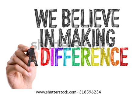 Hand with marker writing: We Believe in Making a Difference - stock photo