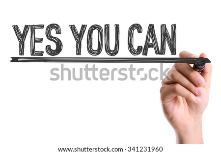 Hand with marker writing: Yes You Can - stock photo