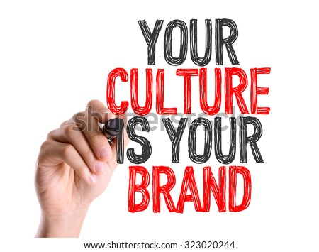 Hand with marker writing: Your Culture Is Your Brand - stock photo