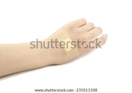 hand with medical plaster - stock photo