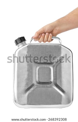Hand with metal jerrycan isolated on white background - stock photo