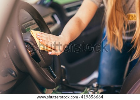 Hand with microfiber cloth cleaning car - stock photo