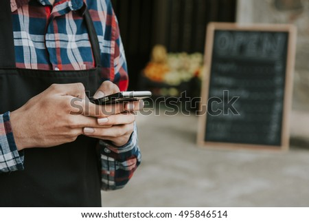 hand with mobile phone, shopping and stores