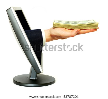 Hand with money and computer monitor - stock photo