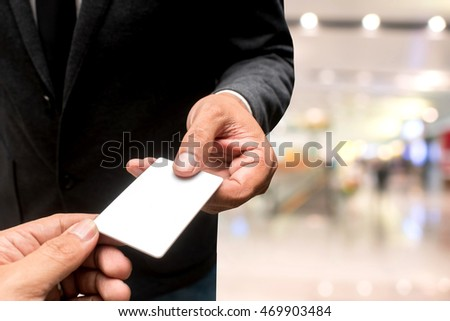 hand with name card with blur background