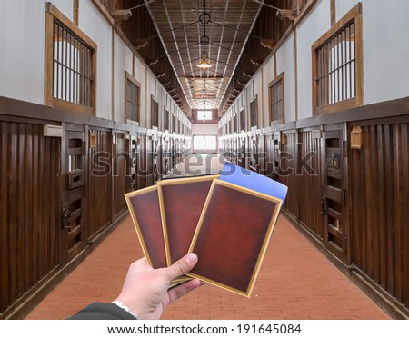 hand with old document in the old wooden abandon prison - stock photo