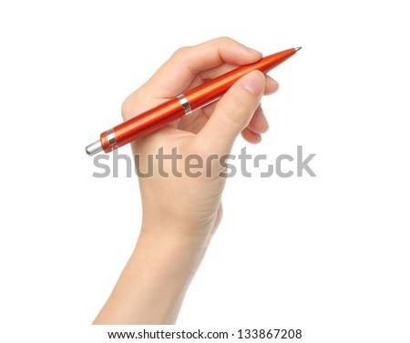 Hand with orange pen on white background - stock photo
