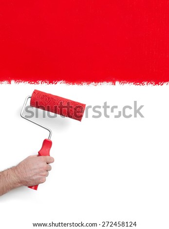 Hand with paint roller - stock photo