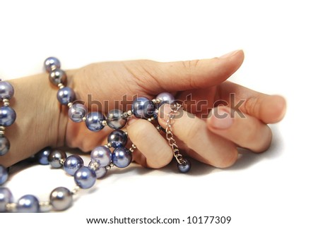 hand with pearl beads, isolated
