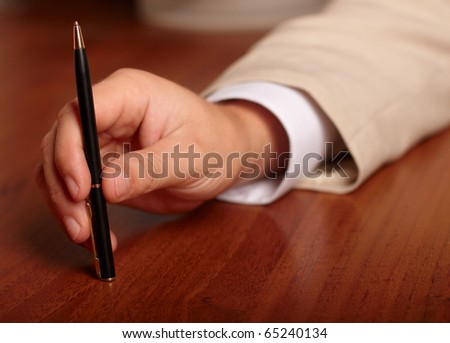 hand with pen - stock photo