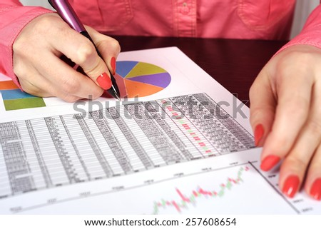 Hand with pen calculate income - stock photo