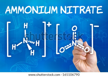 Hand with pen drawing the chemical formula of ammonium nitrate - stock photo