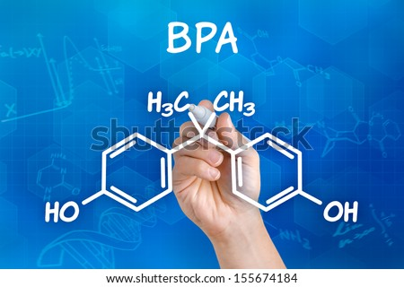 Hand with pen drawing the chemical formula of BPA - stock photo