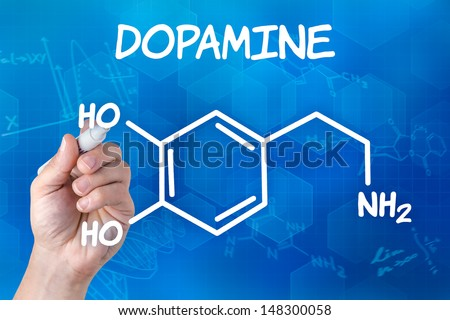hand with pen drawing the chemical formula of Dopamine - stock photo