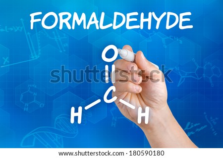 Hand with pen drawing the chemical formula of formaldehyde - stock photo