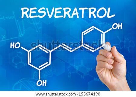 Hand with pen drawing the chemical formula of resveratrol - stock photo