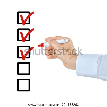 Hand with pen filling out a checklist