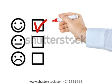 Hand with pen filling out a checklist - stock photo