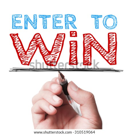 Hand with pen is writing the text Enter to win on the transparent whiteboard. - stock photo