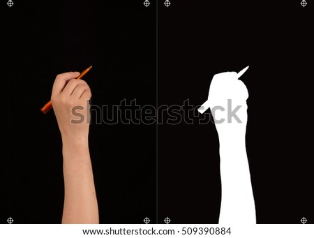Hand with pen on a black background and a mask