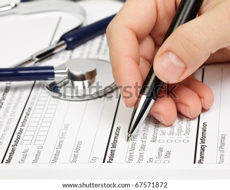 Hand with pen over blank Prescription form with patient information - stock photo